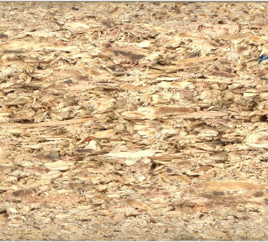 photo of a cross section of particle board